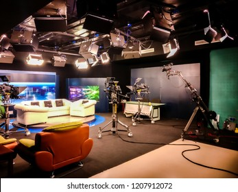 Sharjah, UAE - January 14, 2018: Television studio with camera, lights and coach for interview for recording TV show - University communication collage