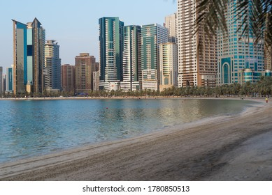 Sharjah, UAE, July 20, 2020, beautiful panoramic view of Sharjah waterfront skyscrapers. Sharjah Skyline it sunset.