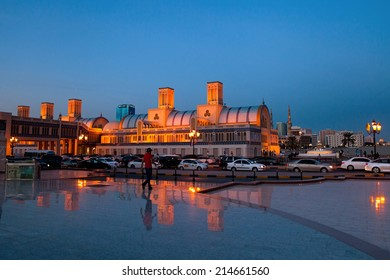Sharjah, UAE - Nov 29, 2013: Blue Souq, a famous marketplace of Sharjah City. Streets full of traffic - rush hour. Twilight just after sunset.