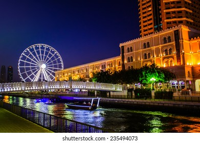 SHARJAH, UAE - OCTOBER 20: Ferris wheel in Al Qasba. Sharjah - third largest and most populous city in United Arab Emirates, on October 20, 2014