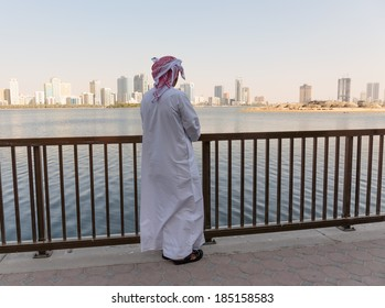 SHARJAH, UAE - OCTOER 28, 2013: Portrait of an unknown Arab men on the waterfront. Sharjah is located along northern coast of Persian Gulf on Arabian Peninsula