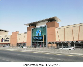 Sharjah, United Arab Emirates - August 14, 2020: Front facade of City Centre Sharjah shopping mall. The large mall is located alongside Al Wahda street in the desert city.