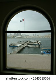 Sharjah, United Arab Emirates: February 02 2017: A view of the Sharjah City from the Al Jubail Souk with the United Arab Emirates flag in view!