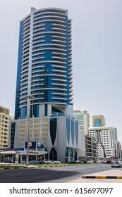 SHARJAH, UNITED ARAB EMIRATES - JUNE 24, 2016: View Sharjah city. Sharjah located along northern coast of Persian Gulf on Arabian Peninsula. Sharjah is the third largest city in United Arab Emirates.