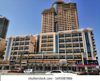 Sharjah, United Arab Emirates, Middle East - April 6, 2020: Modern residential buildings located on Al Wahda Street, opposite Sharjah City Centre shopping mall.