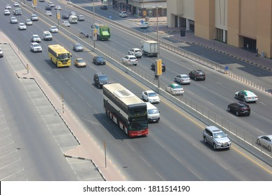 Sharjah, United Arab Emirates - September 9, 2020: Al Wahda Street highway traffic seen with the huge City Centre Sharjah shopping mall. The landmark highway in the city connects to Dubai emirate.