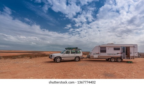"""SHARK BAY, AUSTRALIA - MAY 5 2012: Caravan and SUV parked at the scenic lookout. Many retired Australians known as """"Grey Nomads"""" enjoy touring and camping in similar rigs."""