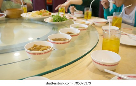 shark fin and fish maw soup in the row on white bowl, Chinese restaurant