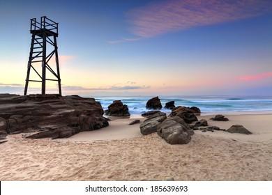 The Shark Tower and jagged rocks at Redhead Beach, NSW Australia