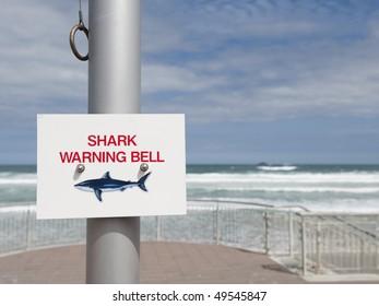 Shark Warning Bell sign and Bell Ringer at St Clair Beach, Dunedin, New Zealand