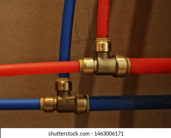 Sharkbite fittings with red and blue PEX pipe.