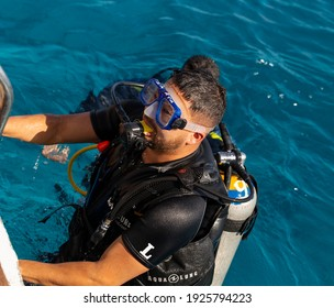 Sharm Ash Sheikh, Egypt - 01.18.2021. Tourists go diving during a cruise on the bay. Sea excursions to the reefs of the Red Sea.