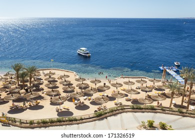 SHARM EL SHEIKH, EGYPT - 17th of February 2013: Beautiful sandy beach with palms in Sharm El Sheikh, Egypt on 17th of February 2013