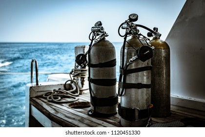 Sharm El Sheikh, Egypt - 6 22 2018 - Two SCUBA cylinders configured in for sidemount diving on boat dive deck