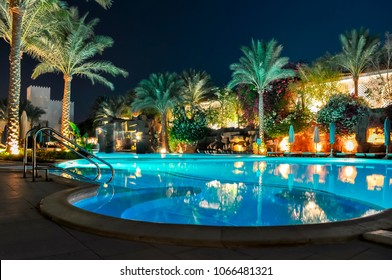 SHARM EL SHEIKH, EGYPT - CIRCA OCTOBER 2017: Swimming pool at night in one of the hotels near beach