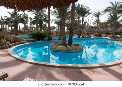 Sharm El Sheikh, Egypt – December 23, 2017 Blue swimming pool in tropical resort hotel on Red Sea, Sinai