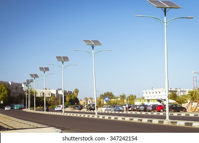 SHARM EL SHEIKH, EGYPT - FEBRUARY 20, 2014: Solar panels on electric pole for lighting on the road in the city, use of solar energy, Sharm El Sheikh, Egypt