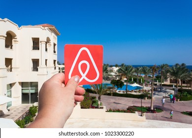 Sharm El Sheikh, Egypt. January, 2018. Travel around the world with Airbnb. Logo Airbnb. House, sea, tree and sky are on the background. Summer travel concept. Rent a house or an apartment.