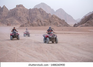 Sharm El Sheikh, Egypt - may 19, 2018 : Quad bikes safari in desert near Sharm El Sheikh, Egypt. Powerful fast off-road four-wheel drive ATVs, motorcycles in sandy desert, rally against high mountains