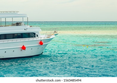 Sharm El Sheikh, Egypt May 08, 2019: Pleasure tourist boat with passengers sailing in the clear blue water of the Red Sea