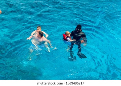 Sharm El Sheikh, Egypt May 08, 2019: Scuba divers dive into the clear blue water in the sea.