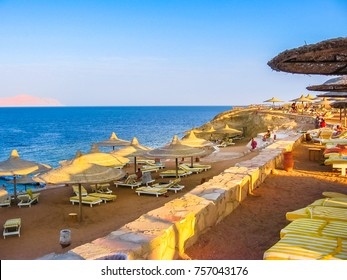 Sharm El Sheikh, Egypt - October 7, 2007: Coral Beach Resort Tiran hotel beach. Beach of a resort for tourists in Sharks Bay with beds and umbrellas. famous reef.