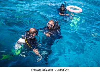 Sharm El Sheikh, Sinai / Egypt - December 01 2016: Diving in the Red Sea, Egypt. Divers in wetsuits
