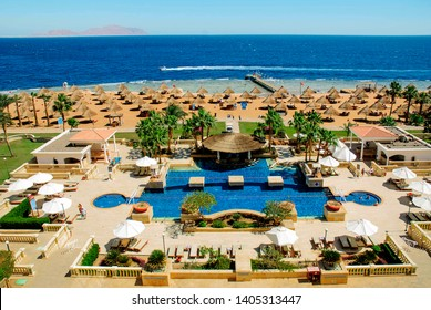 Sharm el-Sheikh, Egypt, March 10, 2019: Resort beach with palm trees and a swimming pool on the shores of the Red Sea, in Sharm el-Sheikh, Egypt.