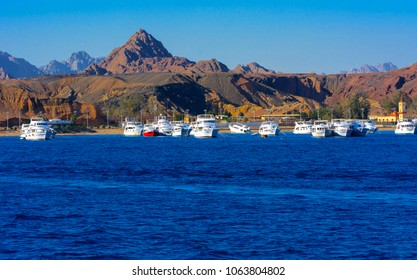 Sharm el-Sheikh, Egypt - March 14, 2018 Luxurious snow-white motor yacht in the bay of the Red Sea against the blue sky of old coral reefs of the unique Ras Mohammed nature reserve, diving, vacation.