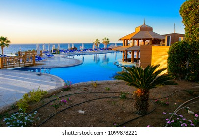 Sharm el-Sheikh, Egypt - March 14, 2018. The courtyards of a magnificent white hotel in the morning. Sunrise. The concept tourism, vacations and luxury recreation. Accommodation in Cyrene Grand Hotel