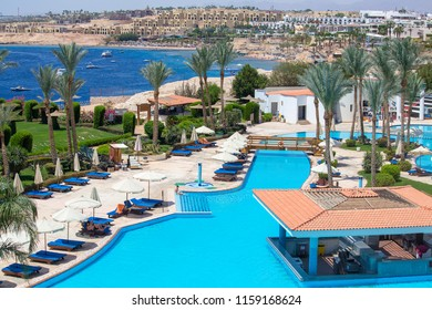 SHARM EL-SHEIKH, EGYPT - MAY 14, 2018 : swimming pool early in the morning next to the red sea in the resort hotel in Sharm El Sheikh, South Sinai, Egypt