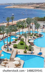 SHARM EL-SHEIKH, EGYPT - MAY 17, 2018 : swimming pool early in the morning next to the red sea in the resort hotel in Sharm El Sheikh, South Sinai, Egypt