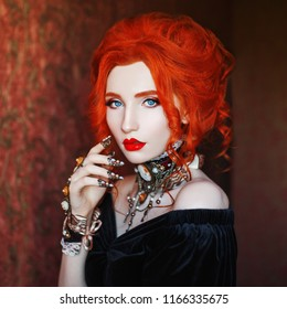 Sharp claws. Dark halloween attire. Sorceress woman is vampire with pale skin and red hair in black dress and necklace on neck. Girl sorceress with vampire claws. Gothic outfit for halloween.