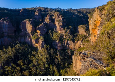 Sharp, craggy cliffs at sunset in the Blue Mountains National Park in Katoomba, Australia.