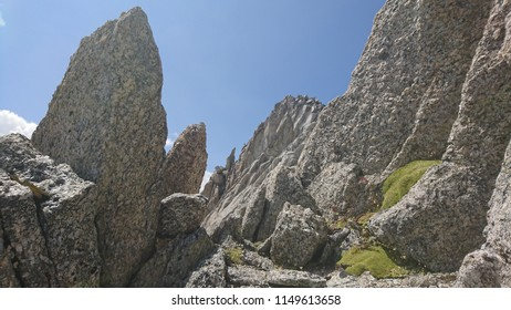 Sharp craggy peak rocks on the way up to a summit in Plateau du Trient region in Switzerland on a gleaming Summer afternoon - Wallis / Valais
