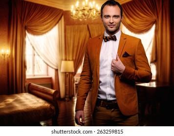 Sharp dressed dandy fashionist in luxury apartment interior