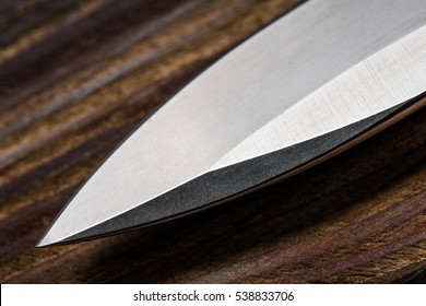 A sharp knife`s blade. Everyday carry knife. Stainless steel pocketknife