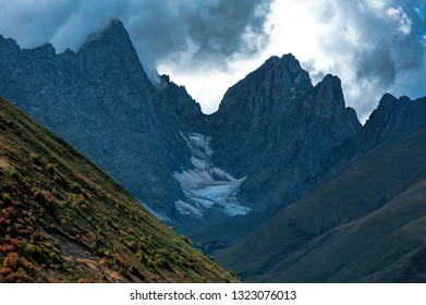 Sharp mountain peaks in the clouds