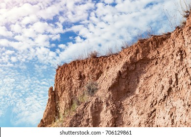 Sharp mountain slope against the blue sky. Warm style