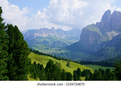 Sharp peaks rise above alpine summer meadows in the Dolomites Alps, Italy