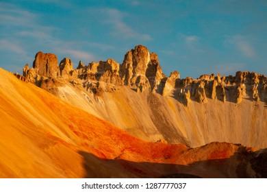 sharp rocky edge of Tunupa volcano crater by sunny morning in Bolivia