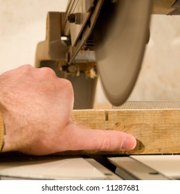 A sharp saw blade is going to cut of a workers thumb