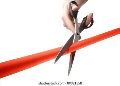 Sharp scissors in mans hand cutting stretched red ribbon studio shoot isolated on white background. Official grand opening or presentation, new business introducing and beginning, launching startup