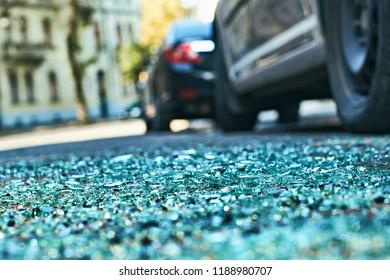 Sharp shards of car glass on the asphalt