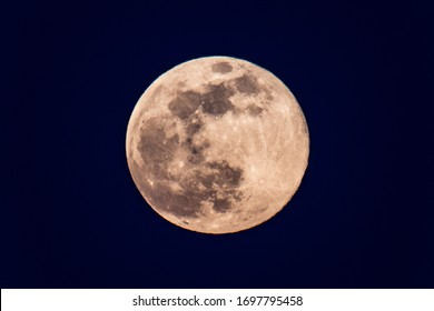 Sharp telephoto close-up of full moon or pink moon on April 7, 2020 from Victoria, BC, Canada