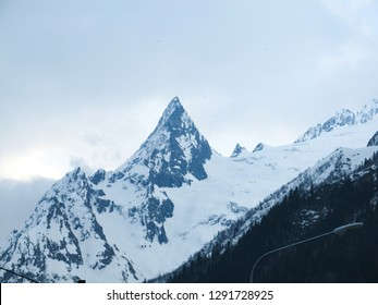 The sharp top of the snow-capped mountain