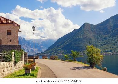 Sharp turn of road near lamn post. Montenegro, Perast town