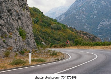 Sharp turn of the road with a sign of falling stones. Balkans, Montenegro
