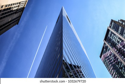 Sharp-cornered building in center of Chicago looks like a ship floating through city.