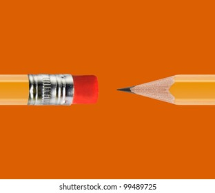 Sharpened Yellow pencil on orange background.